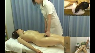 Massage hidden camera films a gal giving handjob