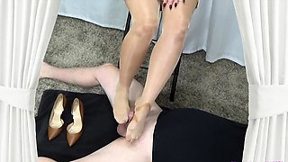 Dominating wife in pantyhose punishes a cock with her feet