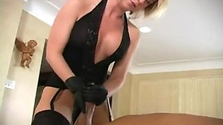 Golden-Haired wearing leather gloves milks bondman for cum