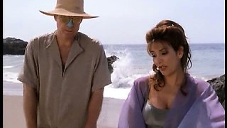 Marina Sirtis sexy on the beach showing us her great