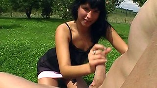 Brunette Renate plays with her tits in outdoors and gives a blowjob