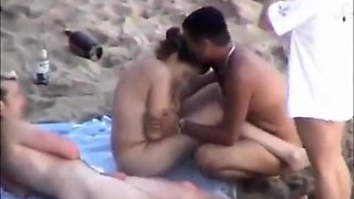 Voyeur tapes nudists fucking eachother's gf on a nudist beach