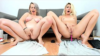 Two beautiful and horny babes masturbate together on webcam