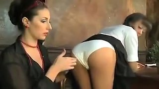 Head Mistress punish a school girl