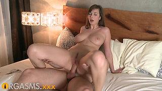 ORGASMS Big breasted brunette orgasms through intimate sex