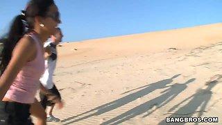 Amanda and Malli Abdallah get naughty on the beach