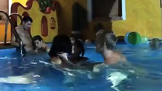 Wild group fucking in the pool