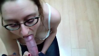 Busty girl with glasses milks a cock with her lips in public