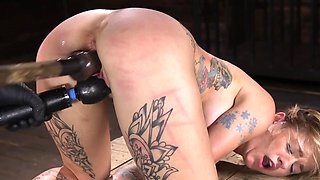 Busty blonde dominated with big vibrator and sex machine