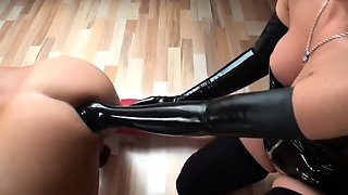 Submissive guy has a busty dominatrix fisting his hungry ass