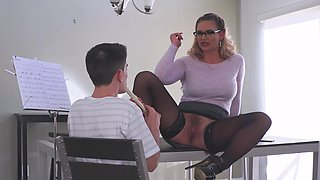A bitch with glasses is on top of a young dude's big cock