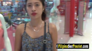 Petite filipina opens up her legs after a day at the mall so she can relax by taking this long dick