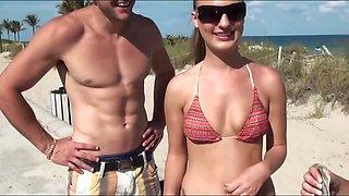 A pair of bikini babes get paid cash on the beach to jump
