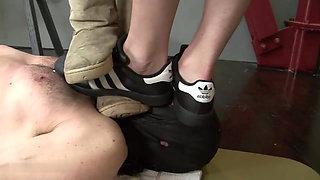 Uggs and sneakers trampling slave