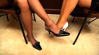 Two elegant lesbian friends licking each other's sexy feet