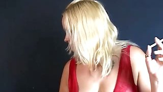 Big breasted blonde slut smoking and playing with her tits