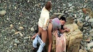 Beach voyeur spies on a wild amateur couple having hot sex