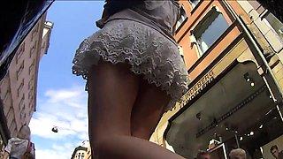 Elegant European babe with wonderful legs upskirt outside