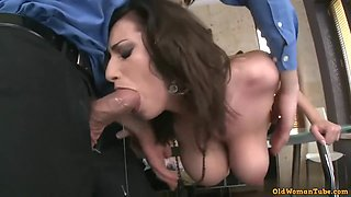Amazing secretary is using her big tits to give a hard- on to her handsome boss