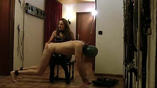 Sissy serf gets some hardcore flogging from his domina