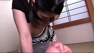 Big breasted Asian mom feeding a kinky boy some fresh milk
