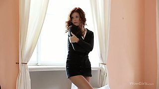 Mia Sollis strips on the bed revealing her stunning body