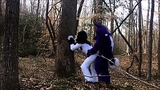 Kinky lovers in funny costumes enjoy doggystyle sex outside