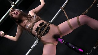 Helpless Asian babe has a mechanical toy drilling her cunt