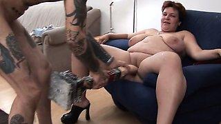 Tattooed skinny guy takes dildo from fat wife