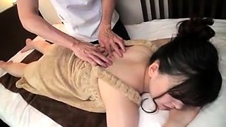 Lovely Japanese babe has a masseur plowing her tight pussy