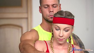 Handsome personal trainer fucks sexy blonde at the home gym