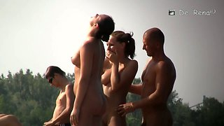 Horny nudist girls simulate oral sex on the beach on camera