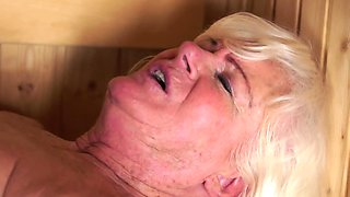 Blonde lusty mature engages in oral sex and gets banged