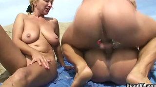 2 MILFS fucking at the beach