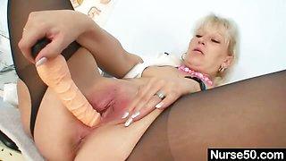 Blond milf in latex uniform extreme dildo insertion