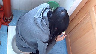 Hot video of an Asian chick pissing in the public toilet