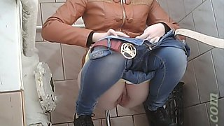 White lean young chick in the toilet room got her pussy filmed on cam