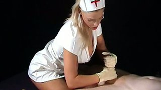 Nurse in latex gloves gives a handjob