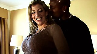 Blonde MILF pornstar Sara Jay in interracial sex