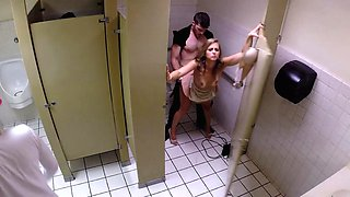 Super-horny bitch and her fucker have sex in the public restroom