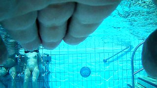Wild amateur lovers getting naked in the public pool