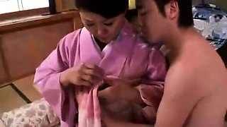 Luscious Japanese housewife has a young man banging her cunt