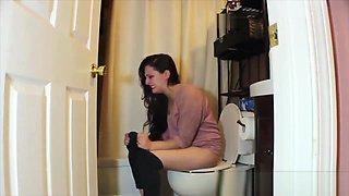 Brunette woman has diarrhea on private toilet
