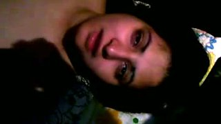 Cute young amateur Indian girl filmed nude on cam in the bedroom