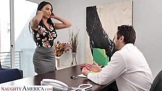 Femme fatale woman Anissa Kate offers herself sitting on the boss's table