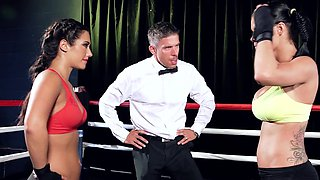 Two hot babes fight and fuck one another and the referee as well