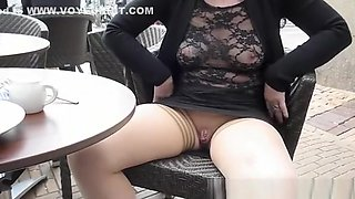 Flashing pierced pussy and tits in cafe